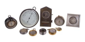 A collection of aneroid barometers and in varying states of repair, late 19th and early 20th century