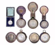 A group of five aneroid pocket barometers, various makers, late 19th and early 20th century