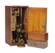 A Victorian lacquered brass binocular microscope, M. P. Tench, London, circa 1870