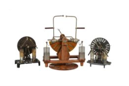 Three Wimshurst pattern electrostatic generating machines, unsigned, early 20th century