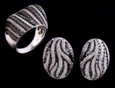 A black diamond and diamond ring