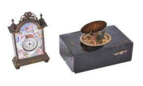 A tortoiseshell musical singing bird box