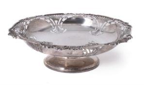 A silver shaped circular pedestal bowl by Walker & Hall