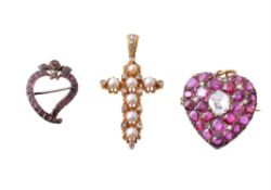 A late 19th century ruby and diamond heart shaped brooch/pendant