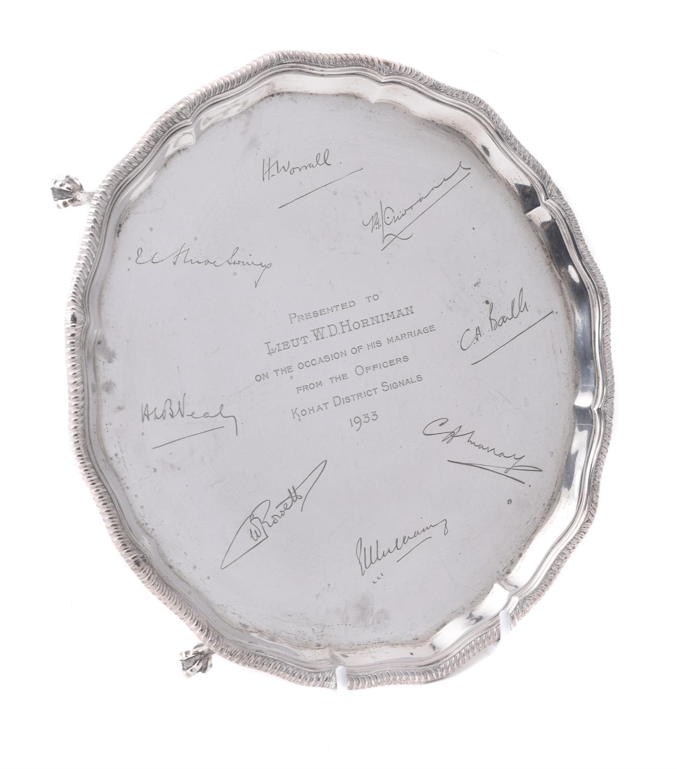 Lot 66 - A silver shaped circular salver by Goldsmiths & Silversmiths Co. Ltd.