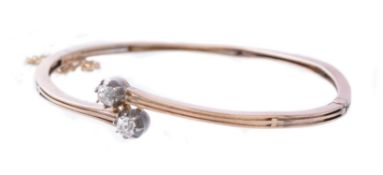 A diamond two stone hinged bangle