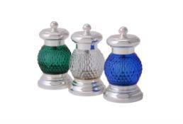 Three coloured glass and electro-plated pepper grinders retailed by Annabel Jones