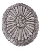 An Ottoman silver coloured small shaped oval mirror