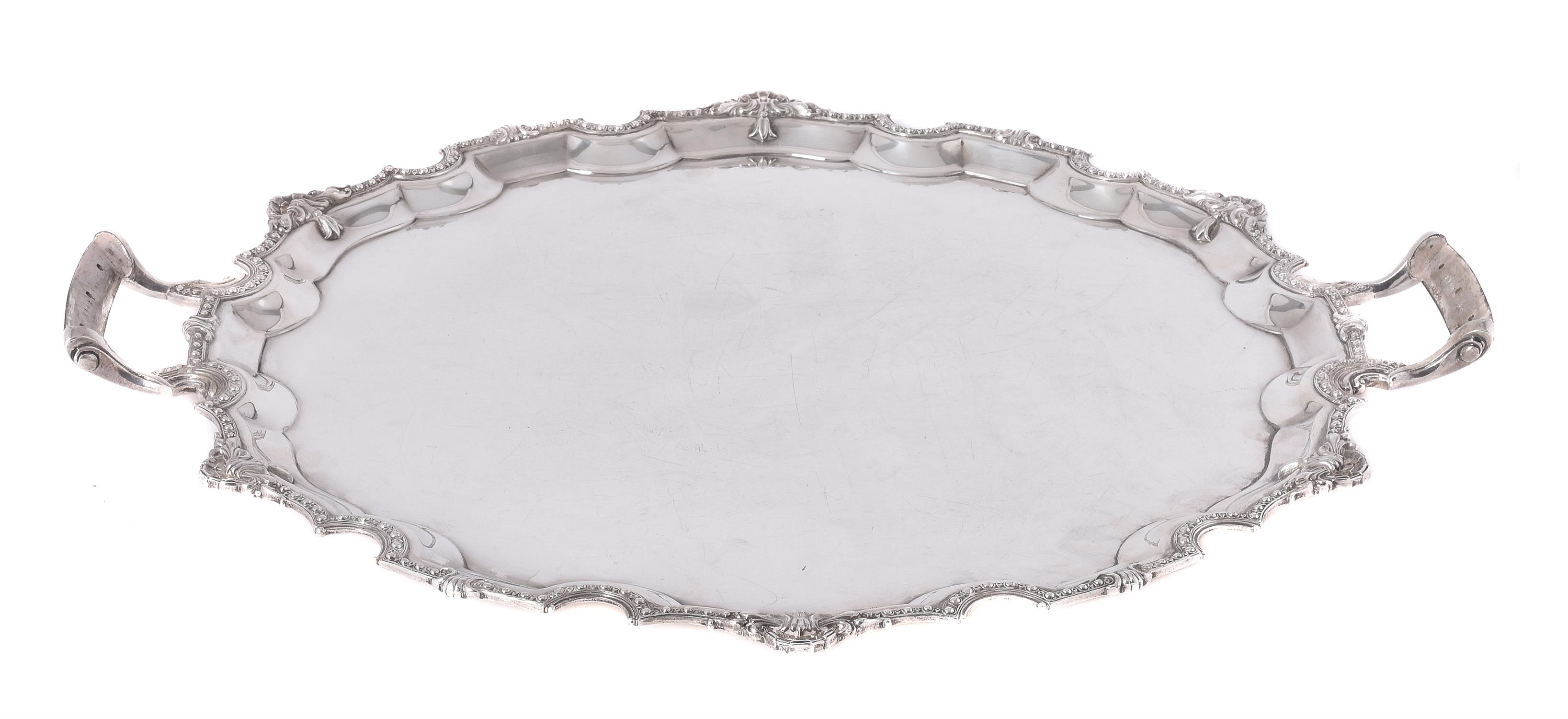 Lot 71 - A silver shaped circular twin handled tray by Mappin & Webb