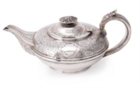A George IV silver circular compressed tea pot by Charles Fox