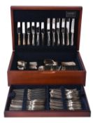 A silver Hanoverian pattern table service for twelve place settings by Carr's of Sheffield Ltd.