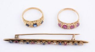 An early 20th century ruby and diamond carved half hoop ring