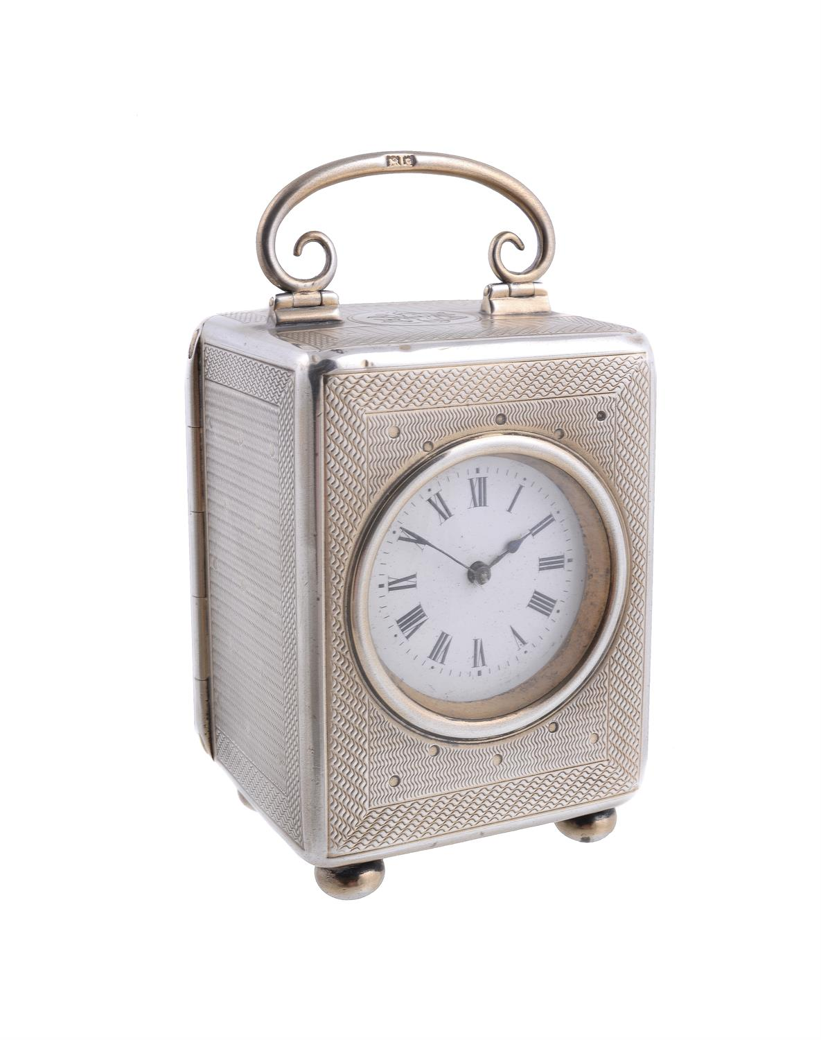 Lot 50 - An Edwardian silver carriage clock by John Pound & Co.