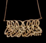 A diamond Koranic text pendant by Adler