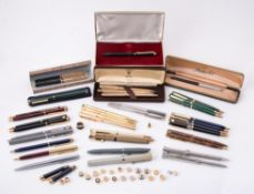 A collection of ball point pens, roller ball pens and propelling pencils