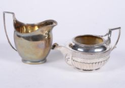 A George III silver circular cream jug by Joseph Guest