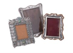 Three silver or silver coloured photograph frames