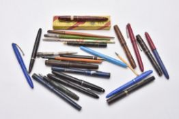 A collection of fountain pens, dip pens and propelling pencils