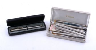 Parker, eight white metal fountain pens and three ball point pens