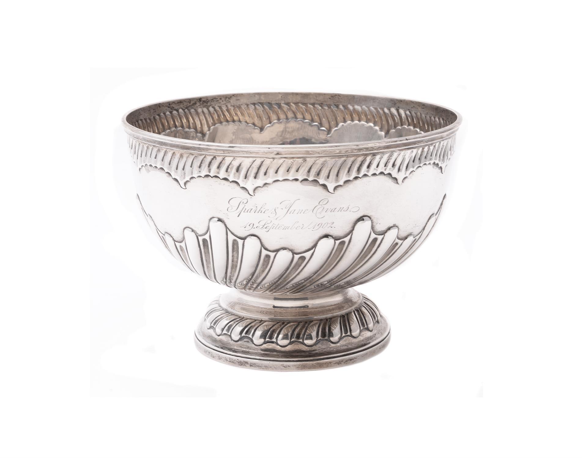 An Edwardian silver circular pedestal punch bowl