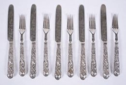 Five pairs of Victorian silver Chased Vine pattern dessert knives and forks by Aaron Hadfield