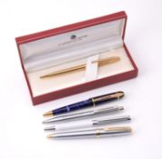 A collection of ball point pens