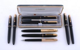 Parker, eight black fountain pens and a propelling pencil