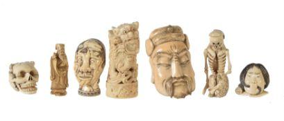A group of seven Japanese ivory Okimono