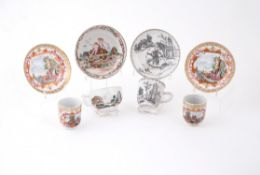 A pair of Chinese famille rose 'Meissen style' cups and saucers