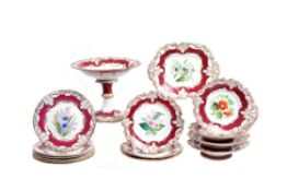 A Ridgway porcelain claret-ground and gilt 'Rococo revival' part dessert service