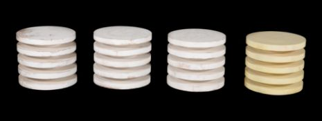 A set of four white painted hardwood occasional tables