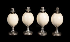 Four ostrich egg and nickel plated candle holders by Anthony Redmile