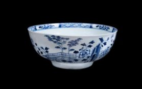 A Liverpool porcelain blue and white chinoiserie punch bowl