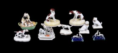 A selection of English pottery and porcelain models of hounds