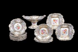 An English porcelain grey-ground and gilt 'Rococo revival' part dessert service