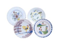 Four various English delft polychrome plates