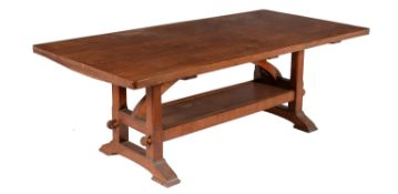 An Arts and Crafts oak refectory dining table