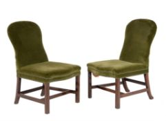 A harlequin pair of mahogany and upholstered side chairs