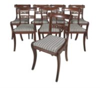 A set of eight Regency simulated rosewood dining chairs