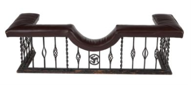 A wrought iron and leather upholstered club fender