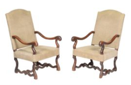 A pair of French oak and upholstered armchairs