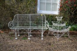 A white painted wrought metal garden seat