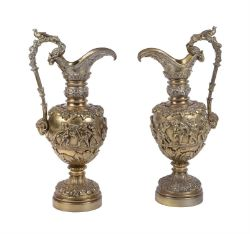 A pair of French gilt bronze ewers in Renaissance Revival taste