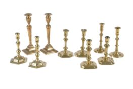 Five various pairs of cast brass candlesticks