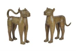 A pair of gold painted metal models of leopards in the style of Benin bronzes