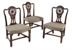A set of three George III mahogany dining chairs