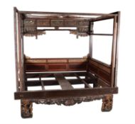 "A Chinese lacquered and parcel gilt ""opium"" bed frame"