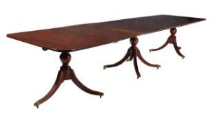 A mahogany triple pillar extending dining table