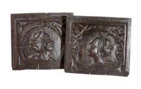 A pair of relief carved oak Romayne panels, probably Franco-Flemish