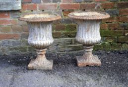 A pair of English or French white painted cast iron jardinieres